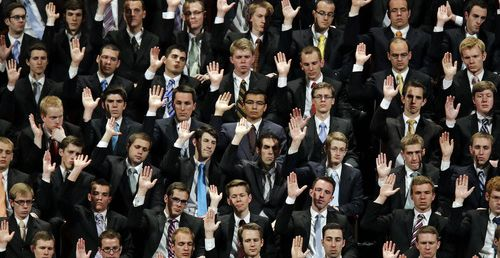 Choir members raise their hands during a sustaining vote at the 183rd Annual General Conference of The Church of Jesus Christ of Latter-day Saints Saturday, April 6, 2013, in Salt Lake City. More than 100,000 members of the church have gathered in Salt Lake City to hear words of inspiration and guidance for daily living from the faith's senior leaders.  (AP Photo/Rick Bowmer)