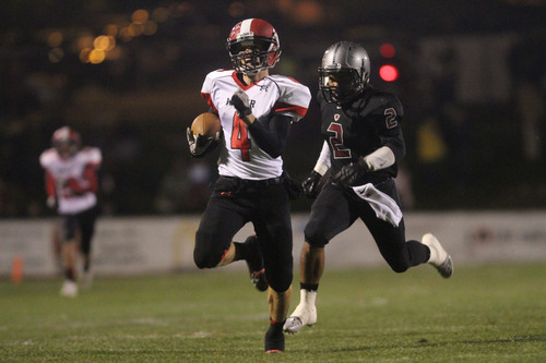 Francisco Kjolseth  |  The Salt Lake Tribune Weber's Mike Baker manages to put in a 89 yard run for a touchdown staying ahead of Houston Lacey of Northridge High in Layton on Thursday night, Sept. 26, 2013.