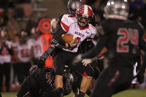 Francisco Kjolseth  |  The Salt Lake Tribune Weber's Mike Baker tries to push through the Northridge High defense in Layton on Thursday night, Sept. 26, 2013.