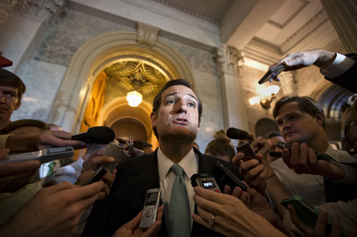 "Sen. Ted Cruz, R-Texas talks to reporters as he emerges from the Senate Chamber on Capitol Hill in Washington, Wednesday, Sept 25, 2013, after his overnight crusade railing against the Affordable Care Act, popularly known as ""Obamacare."" Cruz ended the marathon Senate speech opposing President Barack Obama's health care law after talking for 21 hours, 19 minutes.  (AP Photo/J. Scott Applewhite)"