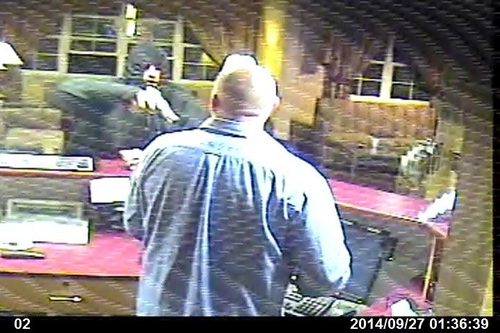 | Courtesy UPD Security camera image from Super 8 Motel robbery.