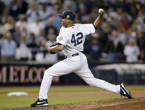 New York Yankees relief pitcher Mariano Rivera (42) delivers against the Tampa Bay Rays in the eighth inning of his final appearance in a baseball game at Yankee Stadium, Thursday, Sept. 26, 2013, in New York. (AP Photo/Kathy Willens)