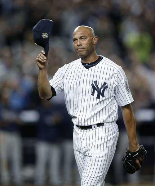 New York Yankees relief pitcher Mariano Rivera (42) tips his cap in the ninth inning of his final appearance in a baseball game at Yankee Stadium, against the Tampa Bay Rays on Thursday, Sept. 26, 2013, in New York. The Yankees won 4-0. (AP Photo/Kathy Willens)