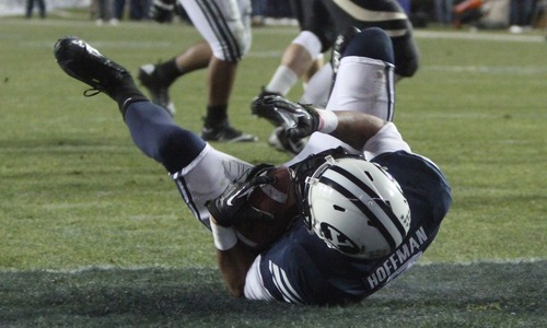 Rick Egan  | The Salt Lake Tribune   Brigham Young Cougars wide receiver Cody Hoffman dives into the end zone for a touchdown, in football action, BYU vs. Idaho Vandals, at Lavell Edwards Stadium, Saturday, November 10, 2012