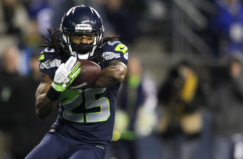 FILE - In this Dec. 30, 2012 file photo, Seattle Seahawks' Richard Sherman intercepts a pass from St. Louis Rams quarterback Sam Bradford in the second half of an NFL football game in Seattle. After an offseason of magazine covers and memorable TV appearances, the Seattle Seahawks All-Pro cornerback is ready for the regular season to begin.  (AP Photo/Stephen Brashear, File)