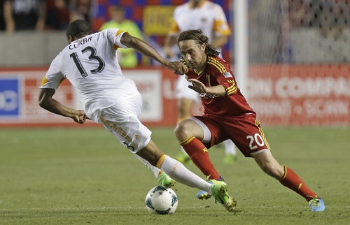Real Salt Lake's Ned Grabavoy (20) defends against Houston Dynamo's Ricardo Clark (13) in the second half during an MLS soccer game Saturday, Aug. 10, 2013, in Sandy, Utah. Real Salt Lake defeated the Dynamo 1-0.  (AP Photo/Rick Bowmer)