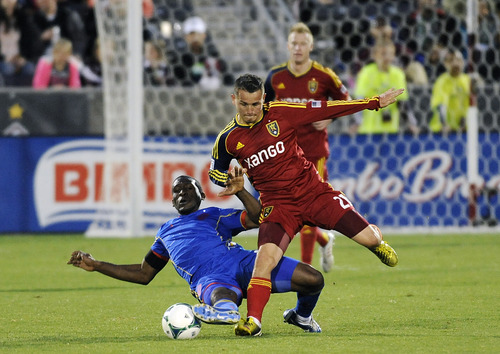 Colorado Rapids midfielder Hendry Thomas, left, of Honduras, goes down as he tries to defend against Real Salt Lake midfielder Luis Gil, right, in the second half of an MLS soccer game in Commerce City, Colo., on Saturday, April 6, 2013. The Rapids won 1-0. (AP Photo/Chris Schneider)