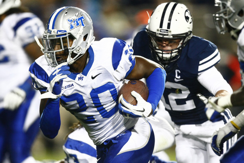 Chris Detrick  |  The Salt Lake Tribune Middle Tennessee Blue Raiders safety Kevin Byard (20) runs past Brigham Young Cougars wide receiver JD Falslev (12) after intercepting the ball during the second half of the game at LaVell Edwards Stadium Friday September 27, 2013.