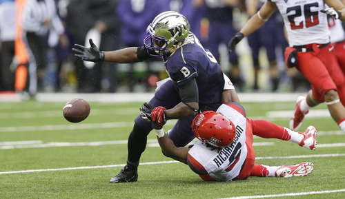 Arizona's Shaquille Richardson breaks up a pass intended for Washington's Kevin Smith (8) in the first half of an NCAA college football game, Saturday, Sept. 28, 2013, in Seattle. (AP Photo/Ted S. Warren)