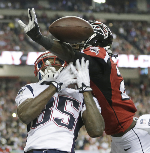 New England Patriots wide receiver Kenbrell Thompkins (85) vies for a thrown ball against Atlanta Falcons cornerback Desmond Trufant (21) during the second half of an NFL football game, Sunday, Sept. 29, 2013, in Atlanta. (AP Photo/John Bazemore)