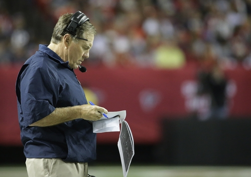 New England Patriots head coach Bill Belichick looks at his notes during the first half of an NFL football game against the Atlanta Falcons, Sunday, Sept. 29, 2013, in Atlanta. (AP Photo/David Goldman)