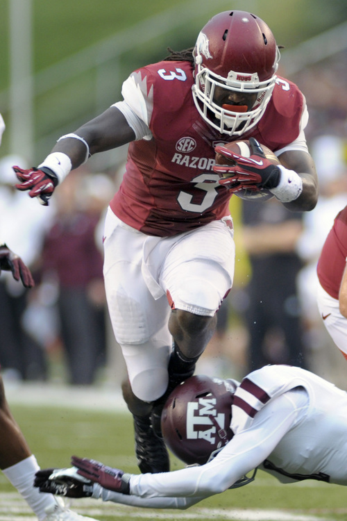 Arkansas running back Alex Collins runs during the first quarter of an NCAA college football game against Texas A&M in Fayetteville, Ark., Saturday, Sept. 28, 2013. (AP Photo/Beth Hall)