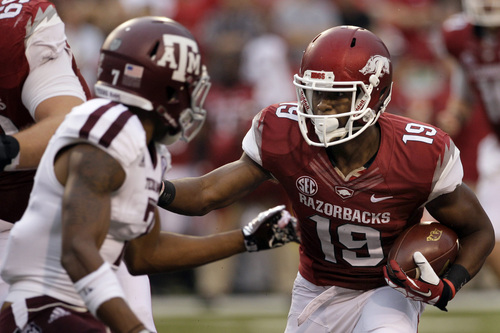 Arkansas wide receiver Javontee Herndon (19) carries against Texas A&M defensive back Tramain Jacobs (7) during the first quarter of an NCAA college football game in Fayetteville, Ark., Saturday, Sept. 28, 2013. (AP Photo/Danny Johnston)