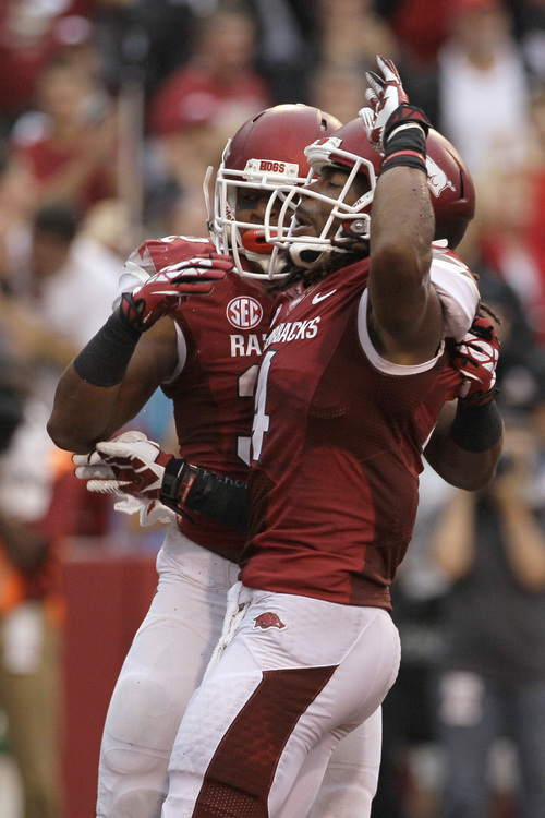 Arkansas running back Jonathan Williams, left, wide receiver Keon Hatcher celebrate Hatcher's first-quarter touchdown in an NCAA college football game against Texas A&M in Fayetteville, Ark., Saturday, Sept. 28, 2013. (AP Photo/Danny Johnston)