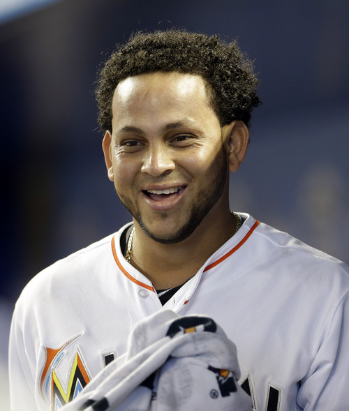 Miami Marlins' Henderson Alvarez smiles in the dugout during the bottom of the ninth inning of an interleague baseball game against the Detroit Tigers, Sunday, Sept. 29, 2013, in Miami. Alvarez pitched a no-hitter as the Marlins won 1-0. (AP Photo/Alan Diaz)