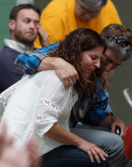 Trent Nelson  |  The Salt Lake Tribune Susan Fleck is comforted by her husband Tim Spier after she spoke at a town hall gathering in North Salt Lake to discuss how to shut down a controversial medical-waste incinerator, Stericycle, in North Salt Lake, Saturday, September 28, 2013.