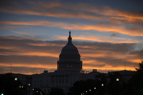 The morning sun illuminates the U.S. Capitol in Washington, Monday, Sept. 30, 2013, as the government teeters on the brink of a partial shutdown at midnight unless Congress can reach an agreement on funding. (AP Photo/J. Scott Applewhite)