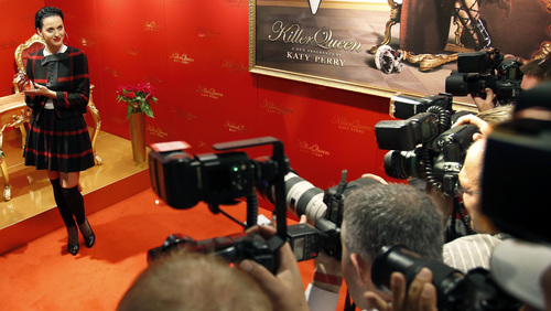 US singer Katy Perry poses for photographers with a body care product during a public relations event at a perfumery in Berlin, Germany, Wednesday, Sept. 25, 2013. (AP Photo/Michael Sohn)
