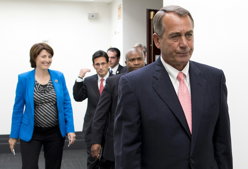 Speaker of the House John Boehner, R- Ohio, is followed by House leadership as he walks to a news conference after a House Republican Conference meeting about the ongoing budget fight on Capitol Hill on Monday, Sept. 30, 2013 in Washington.  (AP Photo/ Evan Vucci)