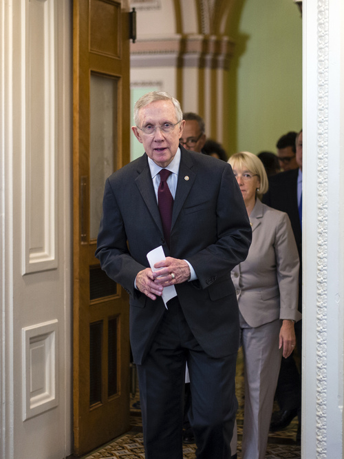 Senate Majority Leader Harry Reid, D-Nev., followed by Sen. Patty Murray, D-Wash., chair of the Senate Budget Committee, arrives to speak to reporters after the Democratic-led Senate rejected conditions that House Republicans attached to a temporary spending bill, at the Capitol in Washington, Monday, Sept. 30, 2013. On the brink of a government shutdown, the Senate voted 54-46 on Monday to strip a one-year delay in President Barack Obama's health care law from the bill that would keep the government operating.  (AP Photo/J. Scott Applewhite)