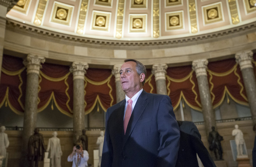 """Speaker of the House John Boehner, R-Ohio, walks to the House floor for a vote on the continuing resolution, at the Capitol in Washington, Monday night, Sept. 30, 2013. The Republican-controlled House and the Democrat-controlled Senate are at an impasse as Congress continues to struggle over how to prevent a possible shutdown of the federal government when it runs out of money. President Barack Obama ramped up pressure on Republicans Monday to avoid a post-midnight government shutdown, saying that failure to pass a short-term spending measure to keep agencies operating would """"throw a wrench into the gears"""" of a recovering economy. (AP Photo/J. Scott Applewhite)"""