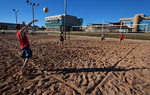 Dixie State College students play volleyball during a pick-up game on the sand volleyball courts on the campus of Dixie State Friday, Feb. 2, 2013.