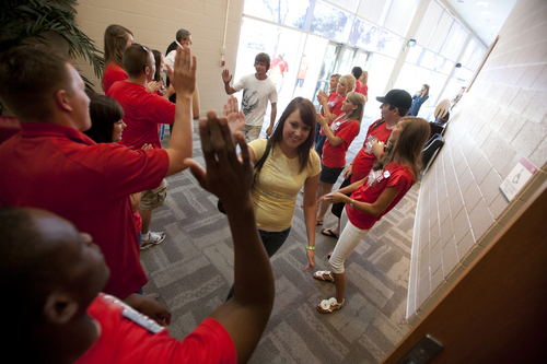 Jud Burkett / The Spectrum Representatives from the Dixie State College Ambassadors, alumni association and student government welcome freshman with cheers and high fives to their freshman orientation Friday, August 20, 2010 at Cox Auditorium on the campus of Dixie State College.