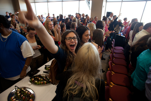 Dixie State College students cheer and clap after the Utah State Board of Regents voted to approve Dixie State's petition for university status Friday, Jan. 25, 2013 on the campus of the college.