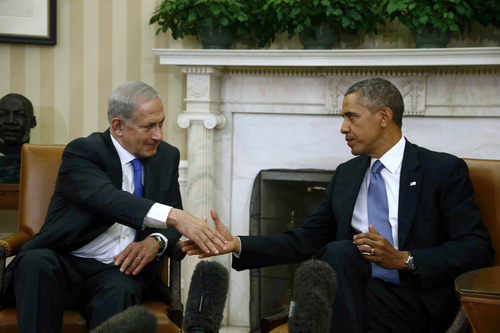 President Barack Obama shakes hands with Israeli Prime Minister Benjamin Netanyahu during their meeting in the Oval Office of the White House in Washington, Monday, Sept. 30, 2013.  The White House said the two leaders would discuss negotiations with the Palestinians, developments in Syria and Iran. (AP Photo/Charles Dharapak)