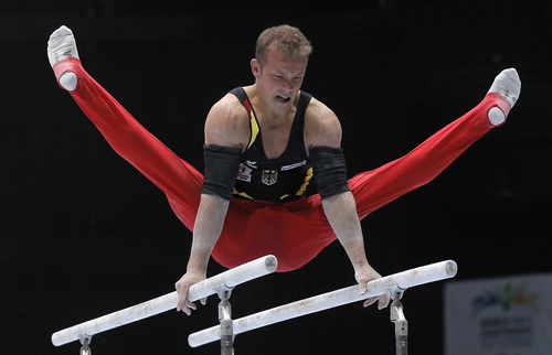 Fabian Hambuechen from Germany performs on the parallel bars during the qualification round at the artistic gymnastics World Championships in Antwerp, Belgium, Monday, Sept. 30, 2013. The event takes place from Sept. 30, until Sunday, Oct. 6. (AP Photo/Yves Logghe)