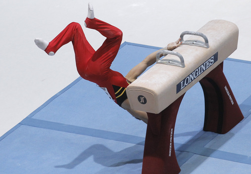 Gymnast Daan Kenis from Belgium falls off the pommel horse, during the qualification round at the artistic gymnastics World Championships in Antwerp, Belgium, Monday, Sept. 30, 2013. The event takes place from Sept. 30, until Sunday, Oct. 6. (AP Photo/Yves Logghe)