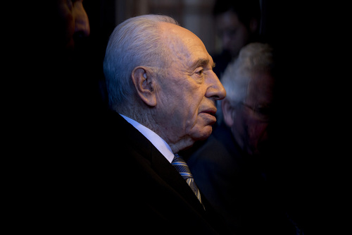 Israel's President Shimon Peres listens to International Court of Justice president judge Peter Tomka of Slovakia in The Hague, Netherlands, Monday Sept. 30, 2013.  The court, also known as Peace Palace, is the principal judicial organ of the United Nations. (AP Photo/Peter Dejong, Pool)