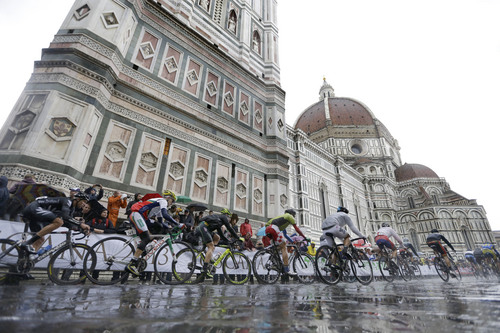 Cyclists ride past the Santa Maria del Fiore Basilica, during the men's elite race, at the road cycling world championships, in Florence, Italy, Sunday, Sept. 29, 2013. (AP Photo/Luca Bruno)