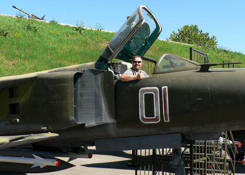 Courtesy photo | Nathan Adams   Nathan Adams sits in a Russian MIG  outside the Great Patriot Museum in Kiev, Ukraine, May 2013. He was visiting  Elena Adamchiyk of Odessa, who he met online in the summer of 2012. She has since arrived in Utah and they plan to marry.