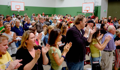 Trent Nelson  |  The Salt Lake Tribune Citizen applaud as Erin Brokovich speaks at a town hall gathering in North Salt Lake to discuss how to shut down a controversial medical-waste incinerator, Stericycle, in North Salt Lake, Saturday, September 28, 2013.