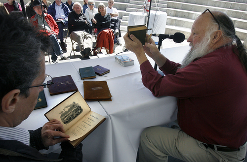 Scott Sommerdorf   |  The Salt Lake Tribune Rare book dealers Tony Weller, left, and Ken Sanders, help collector Kellie Wood with an assessment of her rare collection during a rare book appraisal session at the 16th annual Book Festival, sponsored by the Utah Humanities Council. The event is a two-day outdoor festival taking place on Library Square Saturday and Sunday that includes authors, music, book arts, a poetry slam, writing activities and more, Saturday, September 28, 2013.