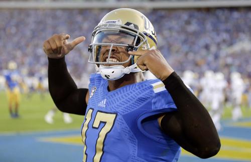 UCLA quarterback Brett Hundley celebrates a touchdown against Nevada during the first half of an NCAA college football game in Pasadena, Calif., Saturday, Aug. 31, 2013. (AP Photo/Chris Carlson)
