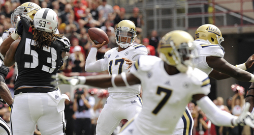 UCLA quarterback Brett Hundley (17) is safe in the pocket as he looks for a receiver in the third quarter against Nebraska of an NCAA college football game Saturday, Sept. 14, 2013, in Lincoln, Neb. (AP Photo/The Journal-Star, Francis Gardler) LOCAL TV OUT; KOLN-TV OUT; KGIN-TV OUT; KLKN-TV OUT