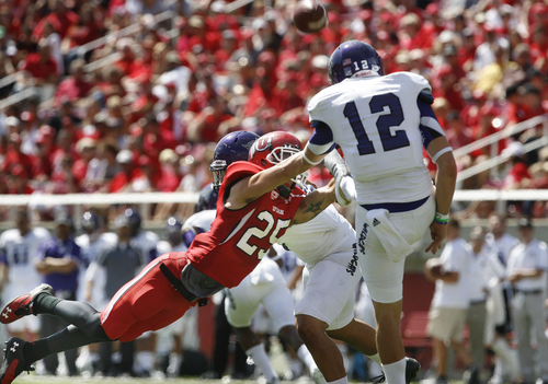 Utah defensive back Mike Honeycutt (25) nearly blocked this punt by Weber State punter Tony Epperson (12) during the first half of an NCAA college football game on Saturday, Sept. 7, 2013 in Salt Lake City.  Utah defeated Weber State 70-7.  (AP Photo/The Salt Lake Tribune, Scott Sommerdorf)  DESERET NEWS OUT; LOCAL TV OUT; MAGS OUT