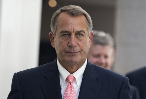House Speaker John Boehner of Ohio walks to a House Republican Conference meeting to discuss the ongoing budget fight, Monday, Sept. 30, 2013, on Capitol Hill in Washington. Republican unity showed unmistakable signs of fraying Monday as Democrats and the White House vowed to reject tea party-driven demands to delay the nation's health care overhaul as the price for averting a partial government shutdown at midnight.  (AP Photo/ Evan Vucci)