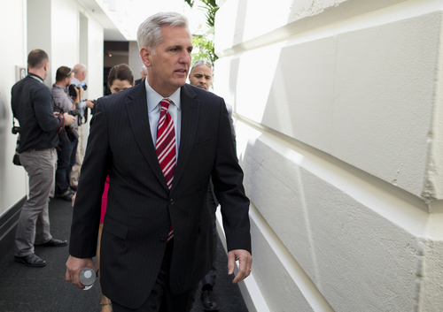 House Majority Whip Kevin McCarthy of Calif. walks to a House Republican Conference meeting to discuss the ongoing budget fight, Monday, Sept. 30, 2013, on Capitol Hill in Washington. Republican unity showed unmistakable signs of fraying Monday as Democrats and the White House vowed to reject tea party-driven demands to delay the nation's health care overhaul as the price for averting a partial government shutdown at midnight.  (AP Photo/ Evan Vucci)