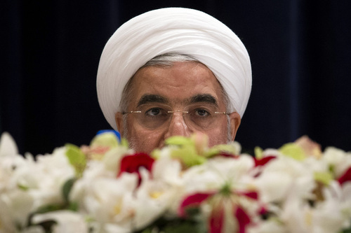 Iranian President Hassan Rouhani speaks during a news conference at the Millennium Hotel in New York's Manhattan borough, Thursday, Sept. 26, 2013. (AP Photo/John Minchillo)