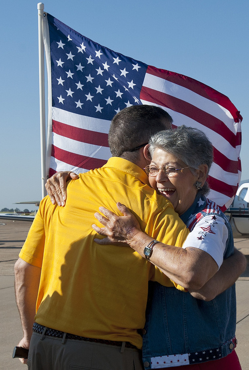 Joyce Shutt hugs retired Army Lt. Col. Kurt Kosmatka of Parma, Ohio, at the Wounded Warriors arrival at the Tyler Pounds Airport Jet Center in Tyler, Texas on Friday, Sept. 27, 2013. Shutt is a member of Welcome Home Soldiers, an organization that provides flag lines, cheers and smiles to military members arriving in the Tyler-Longview area. (AP Photo/The Tyler Morning Telegraph, Sarah A. Miller)