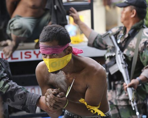 In this photo taken Thursday Sept. 26, 2013, suspected Muslim rebels whom the military said were either captured or surrendered, arrive at a police station for processing in Zamboanga city, southern Philippines. The deadly three-week standoff between government troops and Muslim rebels, who taken nearly 200 people hostages has ended with all of the captives safe, officials announced Saturday Sept. 28, 2013. Defense Secretary Voltaire Gazmin said only a handful of Moro National Liberation Front rebels remained in hiding and were being hunted by troops in the coastal outskirts of Zamboanga city, adding authorities were trying to determine if rebel commander Habier Malik, who led the Sept. 9 siege, was dead. More than 200 people were killed in the clashes, including 183 rebels and 23 soldiers and police, in one of the bloodiest and longest-running attacks by a Muslim group in the south, scene of decades-long Muslim rebellion for self-rule in the largely Roman Catholic country. (AP Photo)
