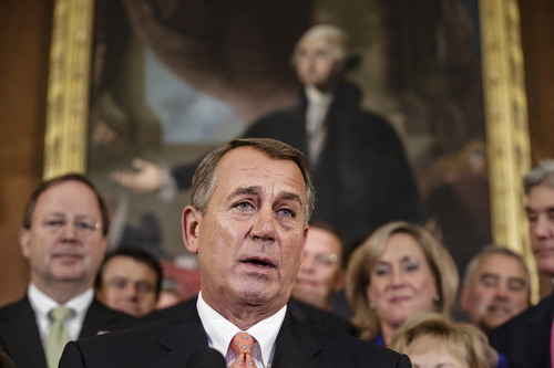 Speaker of the House John Boehner, R-Ohio, and Republican members of the House of Representatives rally after passing a bill that would prevent a government shutdown while crippling the health care law that was the signature accomplishment of President Barack Obama's first term, at the Capitol in Washington, Friday, Sept. 20, 2013.  (AP Photo/J. Scott Applewhite)