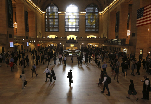 Morning rush hour commuters make their way through Grand Central Terminal,  Thursday, Sept. 26, 2013 in New York. Tens of thousands of Metro-North Railroad commuters scrambled Thursday for alternate routes between the densely populated Connecticut suburbs and New York City after a power failure on a heavily trafficked train line. (AP Photo/Mary Altaffer)