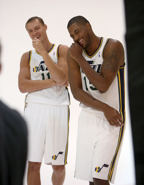 Francisco Kjolseth  |  The Salt Lake Tribune Andris Biedrins, left, and Derrick Favors of the Utah Jazz crack up as they attend Media Day at the Zions Bank Basketball Center in Salt Lake on Monday, Sept. 30, 2013, as the team gets their official team pictures taken and are interviewed by the media.