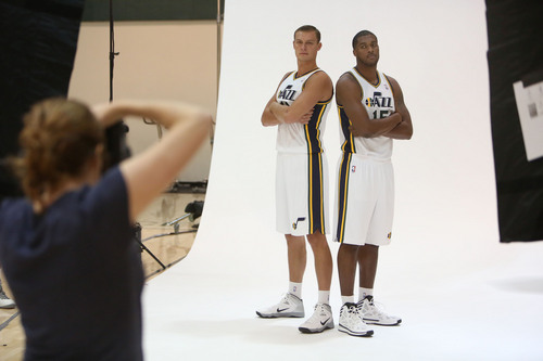 Francisco Kjolseth  |  The Salt Lake Tribune Andris Biedrins, left, and Derrick Favors of the Utah Jazz strike a serious pose as they attend Media Day at the Zions Bank Basketball Center in Salt Lake on Monday, Sept. 30, 2013, as the team gets their official team pictures taken and are interviewed by the media.