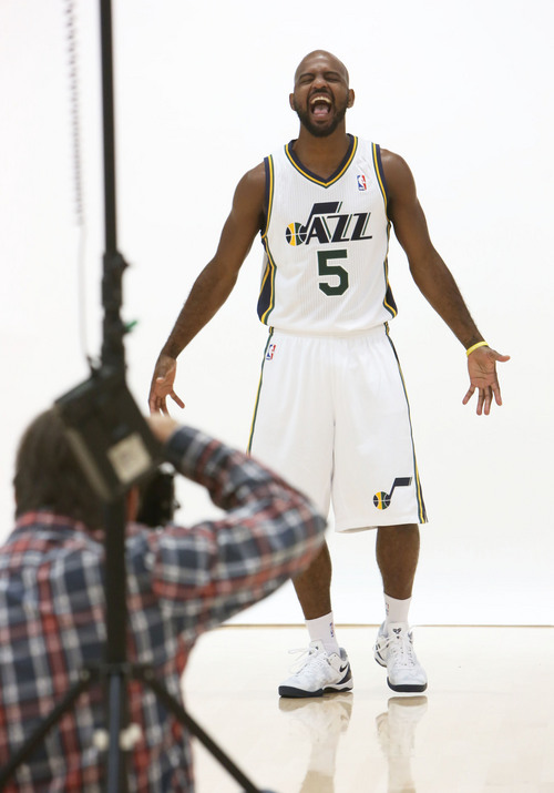 Francisco Kjolseth  |  The Salt Lake Tribune John Lucas III hams it up for the camera as as the Utah Jazz attend Media Day at the Zions Bank Basketball Center in Salt Lake on Monday, Sept. 30, 2013, as the team gets their official team pictures taken and are interviewed by the media.