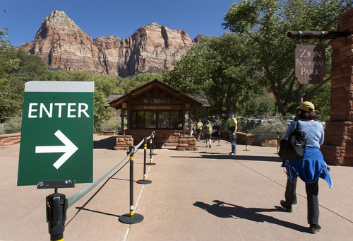 Steve Griffin  |  The Salt Lake Tribune  Park goers use the walk in entrance to Zion National Park  near Springdale, Utah Monday, September 30, 2013. A looming federal government shutdown could close all National Parks.